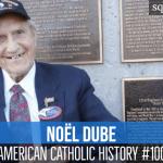 smiling elderly veteran in front of memorial